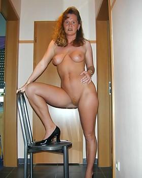 Big titted nanna Rebecca spreading her long legs