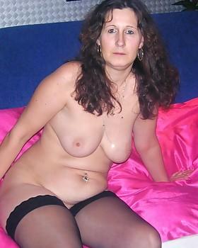 Lusty brunette granny Melissa showing her nice boobies