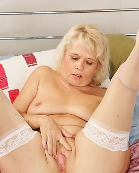 Platinum blond grannie in white stockings Leona strips & dildos slick snatch