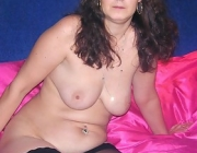 Lusty brunette nanna Melissa showing her nice tits